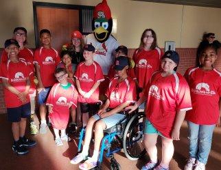 Kids at Cardinal game with fredbird.jpg