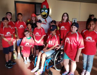 Kids at Cardinal game with fredbird.jpg